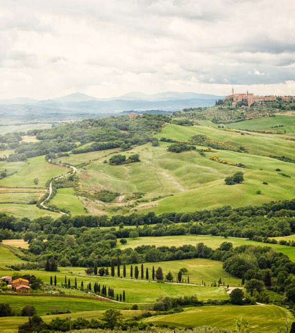 View of the town of Pienza with the typical Tuscan hills from locality of Monticchiello.